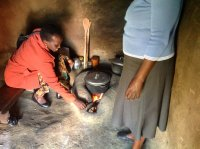 traditional kitchen . . . poor ventilation means eye and respiratory problems . . . Beatrice Limo on left