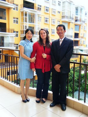 Lucy, Me and Mr. Huang on the balcony of their new flat.
