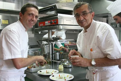 Three star Michelin chefs, Sebastien and Michel Bras, working in the kitchen of their restaurant, Michel Bras, France
