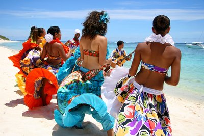 Sega musicians and dancers on the beach