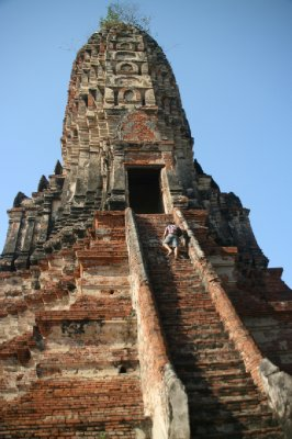 Braving the Stairs of the Central Prang at Wat Chai Wattanaram