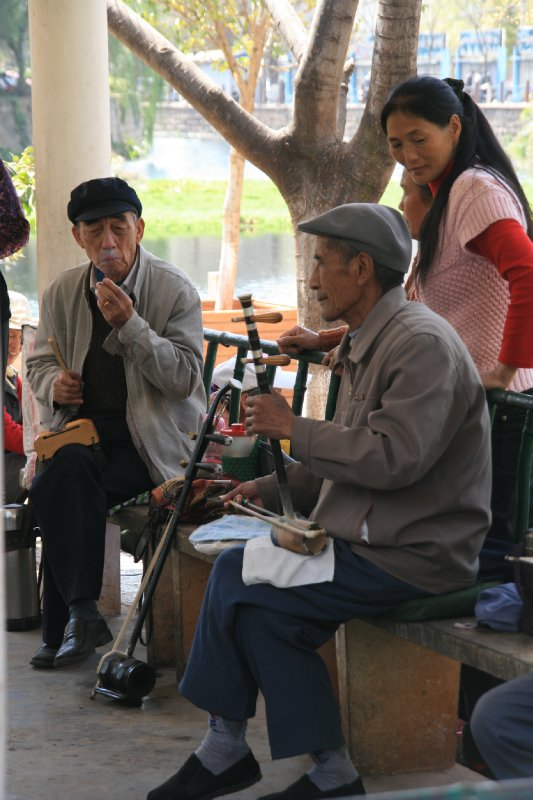 Old Folk Playing Traditional Instruments in the Park