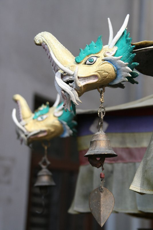 Ornate Dragnon Bells outside a Stupa in Thamel