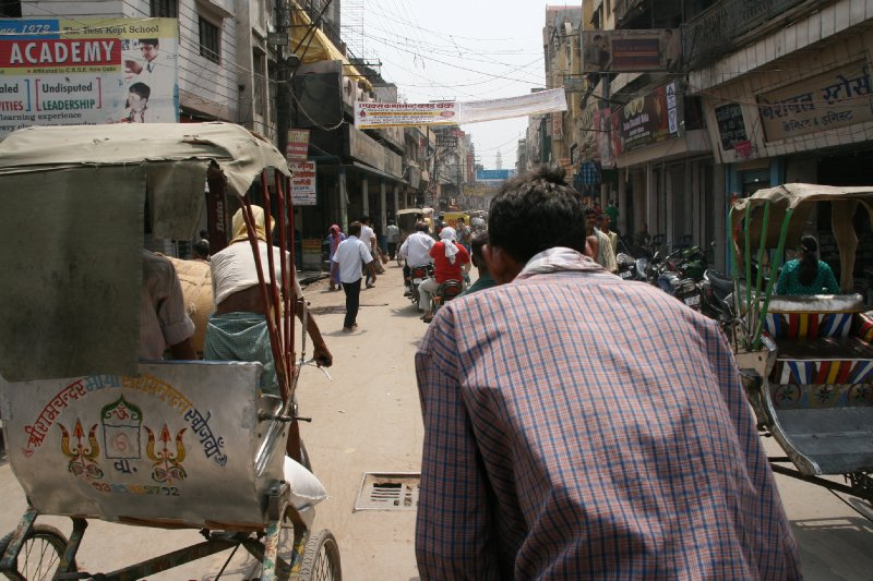 Rickshaw Driver Working Up a Sweat