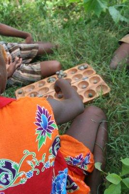 Children playing bao 2
