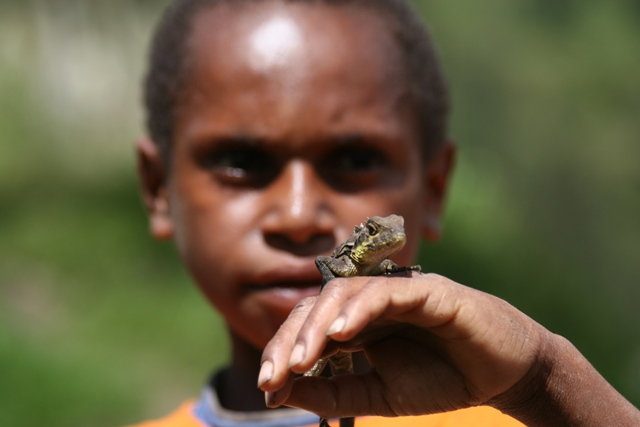 A boy with a lizard