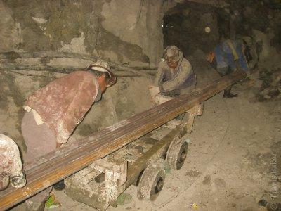Miners bringing new tracks into the mine