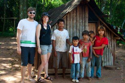 Indigenous family and hut