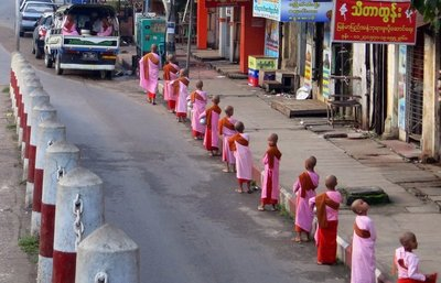 Monks pick their morning alms