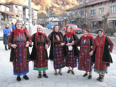 Old ladies from the Pirin Mountains range in traditional costumes
