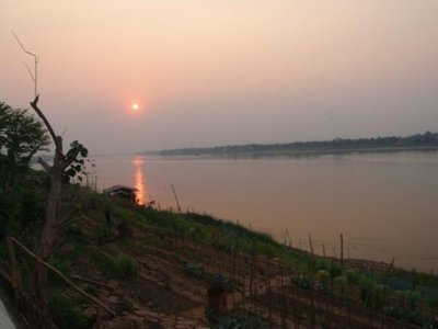 Sunset over the Mekong, not my photo - mine are better <img class='img' src='http://www.travellerspoint.com/Emoticons/icon_smile.gif' width='15' height='15' alt=':)' title='' />