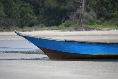 A fisherman's sampan patiently awaits its next outing