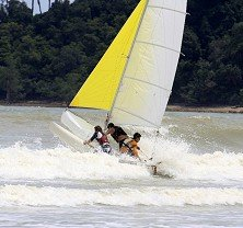 Hard-core Trimaran sailing in the surf off Tanjung Resang