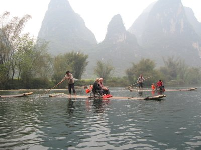 Maurice and Anne on a bamboo raft near Guilin