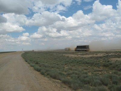 Trucks on the desert road to Aktay, Kazakhstan