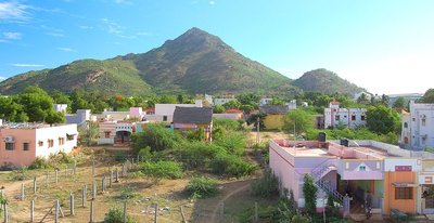 Arunachala hill of Tiruvannamalai, a village sits at the base of the hill