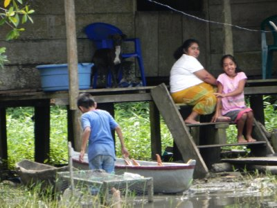 At home on the river - Guatemalan women