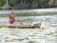 Paddling a kayuka (dug out canoe)