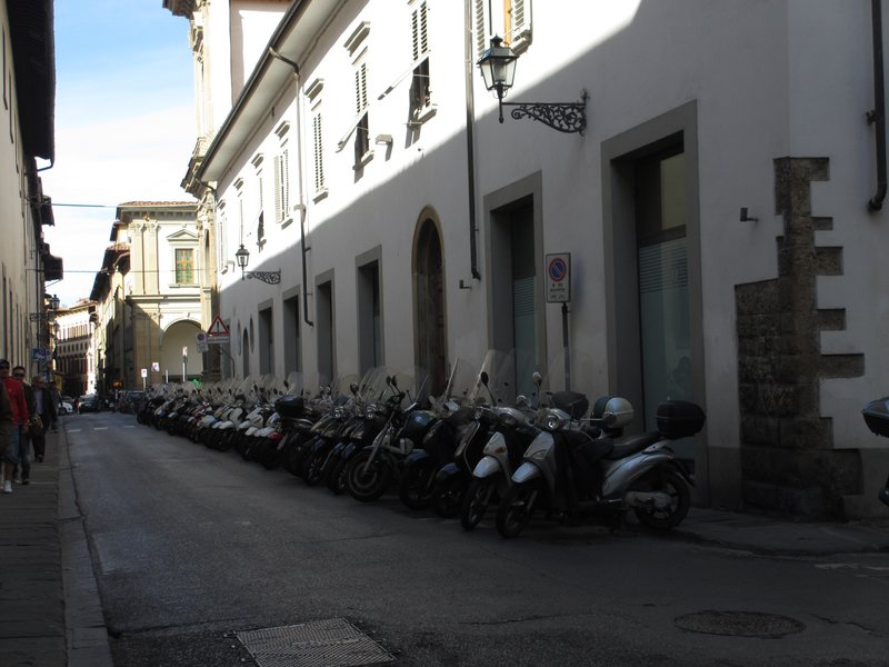 A gaggle of motor scooters