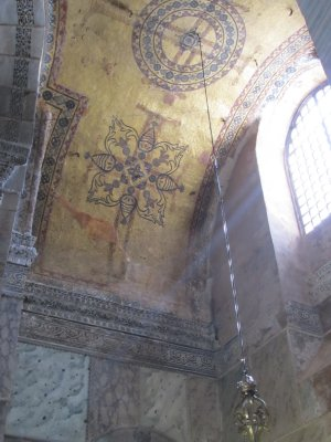 Faint outline of crosses under the most recent artwork