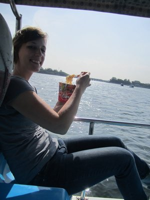 eating ramen on the pedal boat. my legs were so short, i had to sit awkwardly like that to reach the pedals. i thought chinese people were generally short like me?!