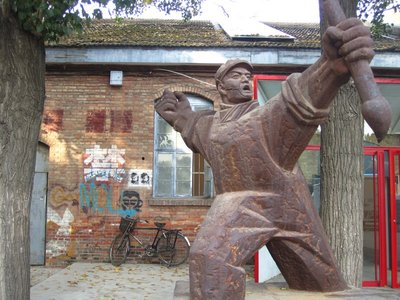 modern sculptures amidst graffitti-laden urban, industrial-turned-art-district background