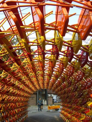 a tunnel made of chairs. one example of the sculptures here.