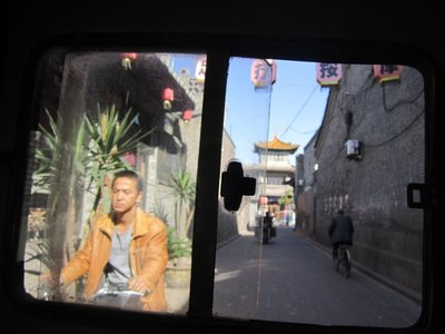 leaving pingyao for the bus to xian in a tuk tuk