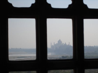 View of Taj from Agra Fort through bars. Shah Jahan, who had the Taj Mahal built, was actually imprisoned by his son in the fort.