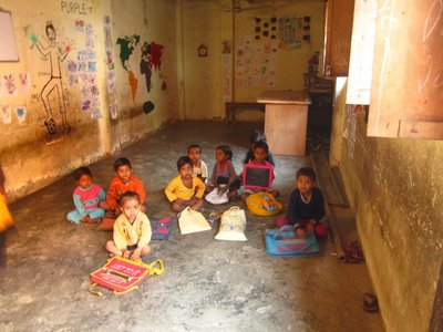 The slum school classroom and just a handful of the younger kids