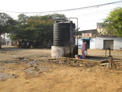 The water pump for the slum right in front of the school.