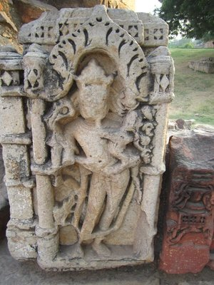 Eroded statue in Qutab Minar