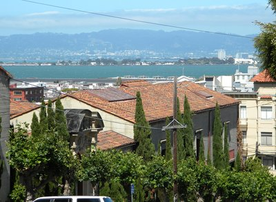 San Francisco Bay view over house roofs