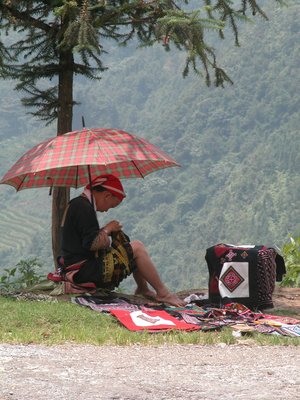 A Red Dzao girl selling handicraft on the roadside - Sapa