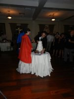 Don't want to get wedding cake on that dress.