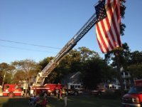 Flag flying from a ladder truck