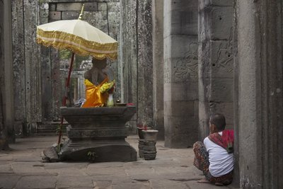 A nun sitting watch in Bayon