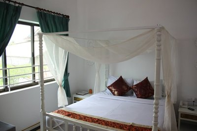 My room at the Frangipani Villa II Hotel in Siem Reap.  I stayed at a Frangipani Hotel in Vietnam and thought it had the most beautiful surroundings of any hotel I'd ever stayed in, so I decided to stay in one in Cambodia as well