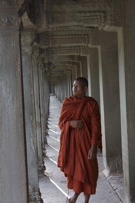 """Our"" monk walking through the outer corridor of Angkor Wat's inner structure.  The next group of pictures all feature him"