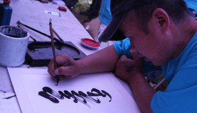 A Mongolian caligrapher prepares a very special scroll
