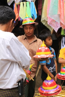 Colorful, hand painted paper hats were popular with the children