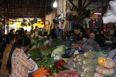 A large market of fruit, vegetables, fresh meat, fish and all manner of other goods