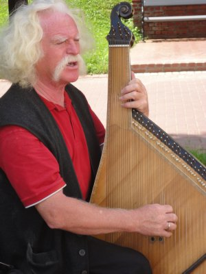 An old man playing with his instrument