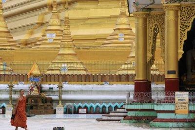 A lone monk wonders through Shwemawdaw Paya