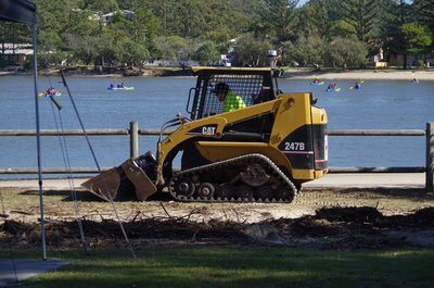 Bobcat working in front of site 12.