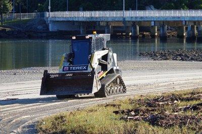 GCCC Bobcat working the beach on Tallebudgera Creek.