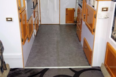 New vinyl in the kitchen area that was overlaid on 6 mm marine ply to strengthen the floor.