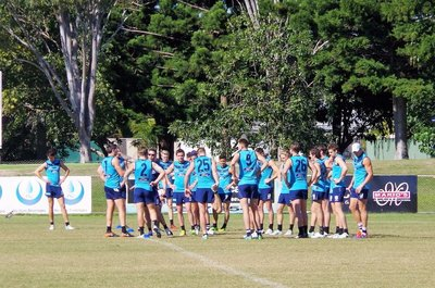 A huddle with the coach prior to training proper.
