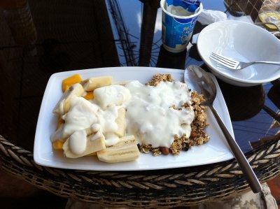 A healthy breakfast of oatmeal, yoghurt, banana and mango in Phnom Penh