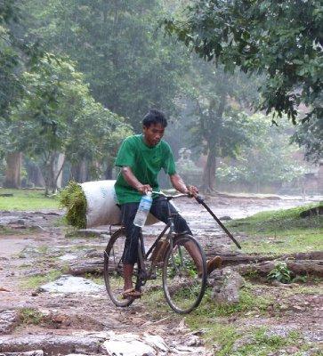 Farmer riding in the rain